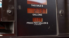 Dollar amount going up on gas pump Stock Footage