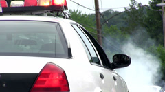 Police car with lights on sitting on side of street Stock Footage