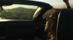 Pretty Teen Girl Riding In A Convertible In A Desert, Talking/Singing. - stock footage