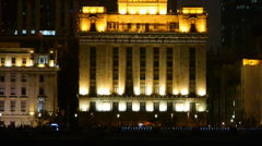Closeup of Shanghai Bund old style building at night,flying red flag. Stock Footage