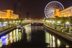 eye of the emirates - ferris wheel in al qasba in shajah, uae - stock photo
