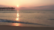 Stock Video Footage of Sunrise at Ocean pier wide angle