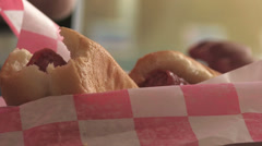 Child eating hot dog meal Stock Footage