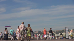 People enjoy walking Promenade Nice Anglais sidewalk boulevard tourist negresco  Stock Footage
