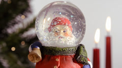Christmas time, santa claus snow globe Stock Footage