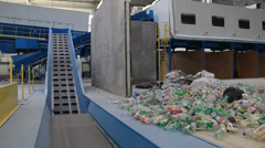 Waste processing, conveyor belt and plastic bottles at recycling center. Stock Footage