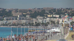 Nice crowded beach umbrella people tourist coastline famous sea town french day Stock Footage