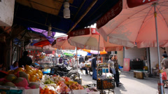 Typical Chinese old town street,shanghai shopping marketplace fruit Stand. Stock Footage