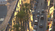 Stock Video Footage of Aerial view traffic street boulevard palm tree car passing people walking Nice