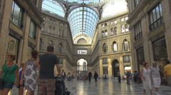Galleria Umberto famous shop brand interior roof people pass Napoli Naples Italy Stock Footage