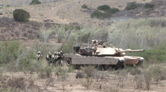 U.S. Marines and Royal Canadian Infantry Regiment conduct a mechanized assault - stock footage