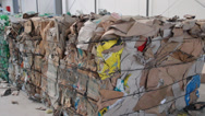 Stock Video Footage of Pressed cubes of waste paper, plastic bottles and cardboard at recycling plant 2