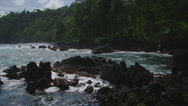 HAWAII – LAUPAHOEHOE POINT – GREEN CLIFFS AND ROCKS IN OCEAN (PAN) Stock Footage