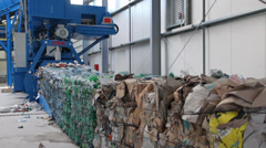 Pressed cubes of waste paper, plastic bottles and cardboard at recycling plant 3 Stock Footage