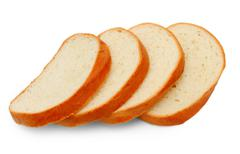 Loaf yummy pieces bread isolated on white background Stock Photos