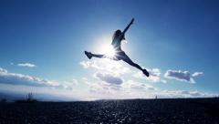 Woman Jumping At Sunset Stock Footage
