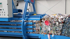 Pressed cubes of waste paper, plastic bottles and cardboard at recycling plant 4 - stock footage