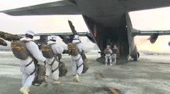 "Arctic Airborne Operation Paratroopers conducted a unique ""tailgate"" jump Stock Footage"