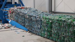 Pressed cubes of waste paper, plastic bottles and cardboard at recycling plant 5 Stock Footage
