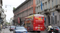 Double Decker Touristic Bus Passing Italian Emergency Police Car Moving Milan Footage