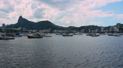 Boats at the bay with Christ the Redeemer in the background, Rio de Janeiro Stock Footage