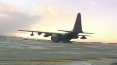 """Arctic Airborne Operation Paratroopers conducted a unique """"tailgate"""" jump Stock Footage"""