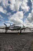 Propeller plane parking at the airport Stock Photos
