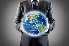 Businessman holds earth in a hands.elements of this image furnished by nasa Stock Illustration