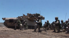 U.S. Marines and Royal Canadian Infantry Regiment conduct a mechanized assault Stock Footage
