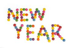 the title new year written of the colored smarties - stock photo