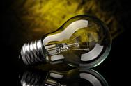 Stock Photo of light bulb on black yellow background