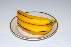 bananas quench hunger, provide organism energy and nutrients - stock photo