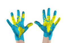 Map painted childs on hands. concept save the world Stock Illustration