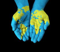 map painted on hands showing concept of having the world in our hands - stock illustration
