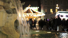 Piazza navona during the Christmas period - fountain of bernini and carousel Stock Footage