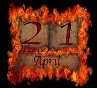 burning wooden calendar april 21. - stock illustration