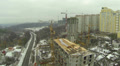 Building house in the winter with cranes. Aerial HD Footage