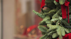 Attractive young woman looking at the shop window with christmas atmosphere Stock Footage