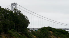 Bridge extends from behind hill Stock Footage