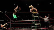 Stock Video Footage of Pro Wrestling Move: Top Rope Dropkick off Ladder