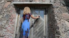 guest woman in dress knock retro rusty door handle - stock footage