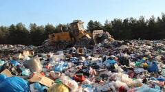 Garbage dump. Bulldozer at garbage landfill. Stock Footage