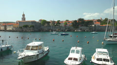 Boats in harbour of old town Krk, Croatia Stock Footage
