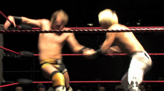 Pro Wrestling Move: Dropkick / Dropsault Backflip - stock footage