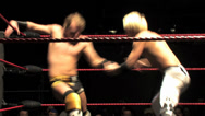Stock Video Footage of Pro Wrestling Move: Dropkick / Dropsault Backflip