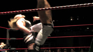 Stock Video Footage of Pro Wrestling Match: Hard Kicks to Chest