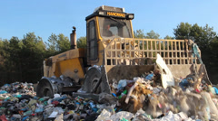 Garbage dump. Bulldozer at garbage landfill. 3 Stock Footage