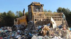 Garbage dump. Bulldozer at garbage landfill. 3 - stock footage
