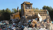 Stock Video Footage of Garbage dump. Bulldozer at garbage landfill. 3