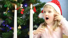 Pretty little girl blowing out candles Stock Footage